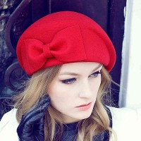 The new autumn and winter hat lady retro style European market and the US market bow beret stewardess cap pure wool hat Ms. Material